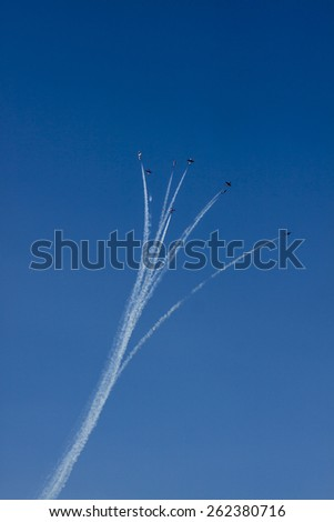 Synchronized Aerial Demonstration for Public Show on Mountain lake - stock photo