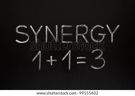 Synergy concept 1+1=3 made with white chalk on a blackboard. - stock photo