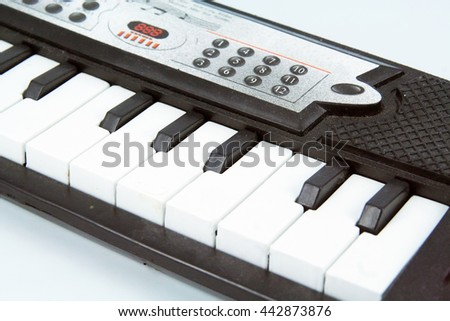Synthesizer toy. Kids music toy. - stock photo
