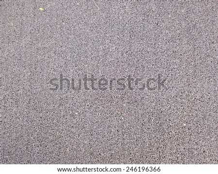 Synthetic grey carpet background texture - stock photo