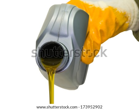 Synthetic motor oil pouring from a plastic canister - stock photo