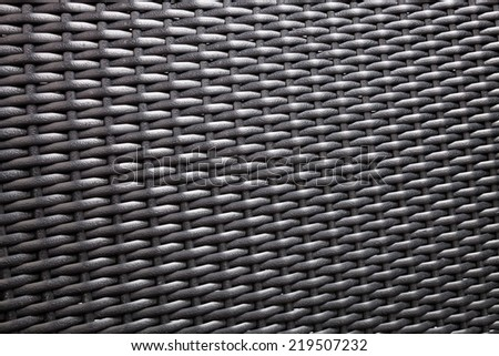 Synthetic rattan texture weaving background - stock photo