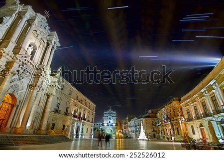 Syracuse includes Ortygia and many remains bear witness of Sicily, from Greek and Romans, Byzantines, Bourbons, Arabo-Muslims, Normans, Aragons.  Piazza Duomo - Unesco World Heritage site. - stock photo