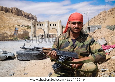 SYRIA, MAALULA - SEPTEMBER 2013. The soldier of the Syrian National Army at the gates of the city Ma'loula. Ma'loula became a place of fighting between Assad forces and the rebels. - stock photo