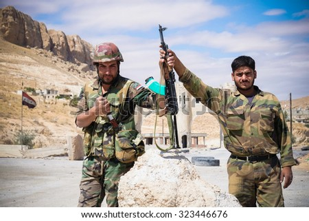SYRIA, MAALULA - SEPTEMBER 2013. The soldiers of the Syrian National Army at the gates of the city Ma'loula. Ma'loula became a place of fighting between Assad forces and the rebels. - stock photo
