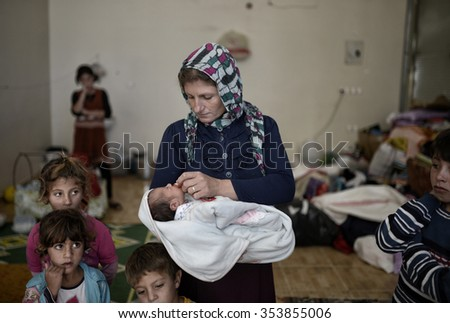 Syrian refugees families who came from Kobani district living in refugees tent in Suruc district, 20 October 2015 , Turkey , Sanliurfa.  - stock photo