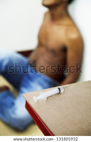 Syringe and drug addict - stock photo