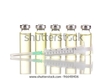 Syringe and medical ampoules isolated on white - stock photo