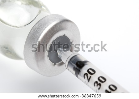 Syringe and vial macro photography - stock photo