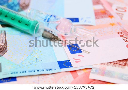 syringe for euro banknotes. - stock photo