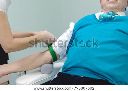 Syringe in the hands for taking a blood sample from patient.