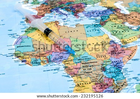 syringe on a map of africa  - stock photo