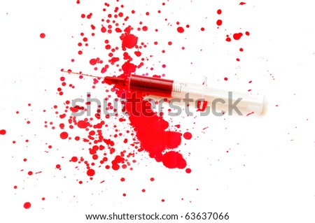Syringe with a red liquid and stains