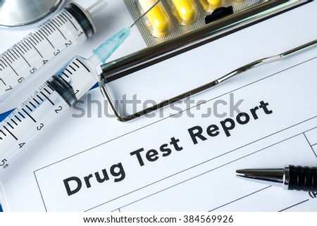 Syringe with glass vials and medications pills drug test report - stock photo