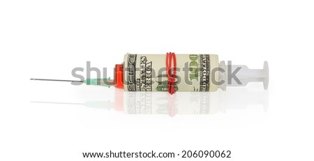 Syringe wrapped in banknote isolated on white background - stock photo
