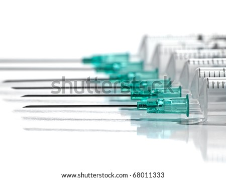syringes in the row over white background, for  medical,health care or pharmacy themes - stock photo