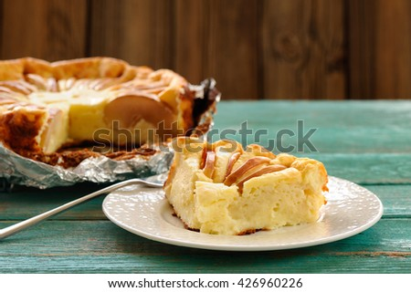 Syrnik, homemade quark pie with apples on old wooden table - stock photo