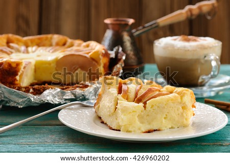 Syrnik, quark pie with apples served with Vienna coffee on old wooden table - stock photo