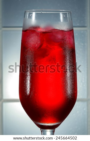 syrup with some ice cubes - stock photo