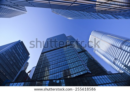Syscrapers in Hong Kong in daytime, blue tone - stock photo