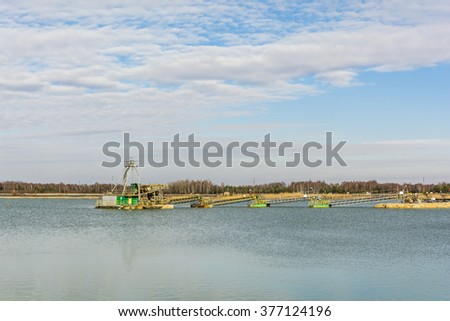 System for the extraction of the gravel pit aggregate in the water.  - stock photo