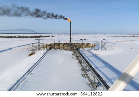 System of a torch on an oil field. Area flare system. - stock photo