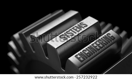 Systems Engineering on the Metal Gears on Black Background.  - stock photo