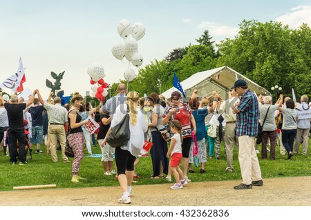 SZCZECIN, POLAND - JUNE 03, 2016: Many people participating on a KOD protest against the ruling party PIS on a park - stock photo