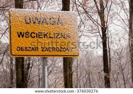 Szczecin, Poland - March 31, 2015: Warning sign for Rabies crossing on Polish forest