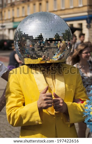 SZCZECIN, POLAND - MAY 23, 2014: Juwenalia, is an annual students' holiday in Poland, usually celebrated for three days in late May. Disco Ball Man posing for photos in the street. - stock photo