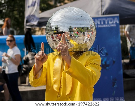SZCZECIN, POLAND - MAY 23, 2014: Juwenalia, is an annual students' holiday in Poland, usually celebrated for three days in late May. Disco Ball Man dancing in the street. - stock photo