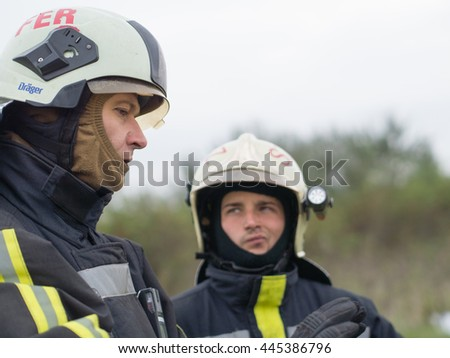 Szeged, Algyo, Hungary - October 8, 2015: Regional fire-fighting exercise in the training area with urban and contract firefighters. Exchange of experience