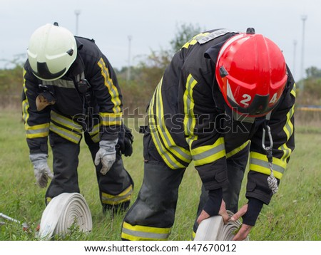 SZEGED, HUNGARY - October 8, 2015: Regional fire-fighting exercise in the training area with urban and contract firefighters. Placing the equipment is in progress.