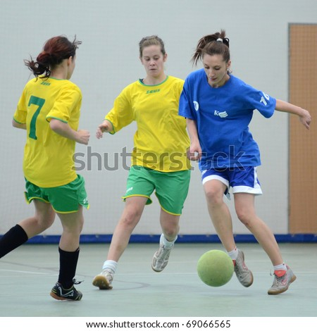 SZENNA, HUNGARY - JANUARY 15: Unidentified players in action at a Somogy Sporja Girl Futsal Competition match between Fonyod and Kaposvar University January 15, 2011 in Szenna, Hungary. - stock photo