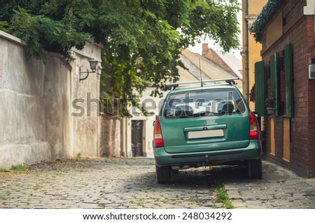 SZENTENDRE, HUNGARY,  a green machine at narrow street - stock photo