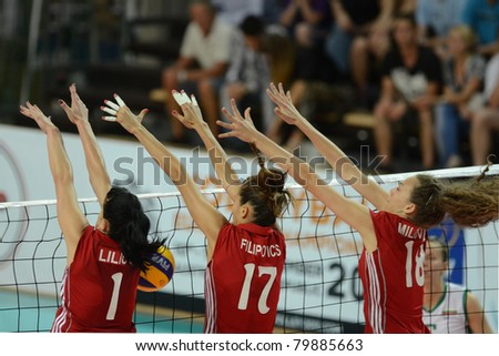 SZOMBATHELY, HUNGARY - JUNE 4: Anita Filipovics (in red 17) in action at a CEV European League woman's volleyball game Hungary vs Bulgaria on June 4, 2011 in Szombathely, Hungary.