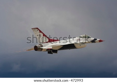 T-Bird launch into dark skies - stock photo