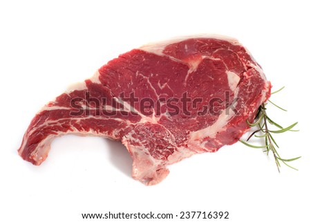 T-bone steak in front of white background