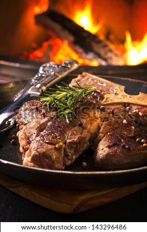 t-bone steak in the frypan - stock photo