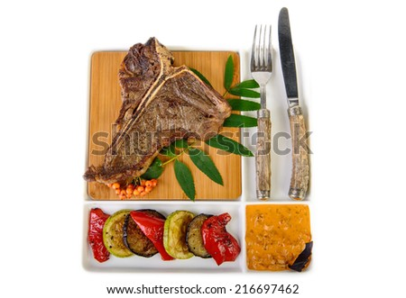 t-bone steak with rowan top view - stock photo