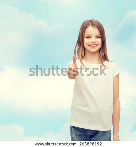 t-shirt design and happy people concept - smiling little girl in blank white t-shirt showing thumbs up - stock photo
