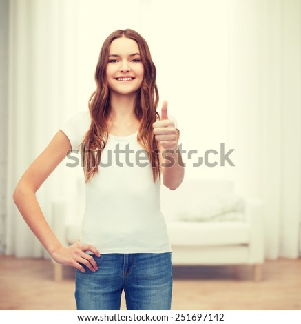 t-shirt design concept - smiling teenager in blank white t-shirt showing thumbs up - stock photo
