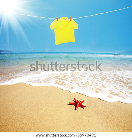 T shirt with  red starfish on beach - stock photo