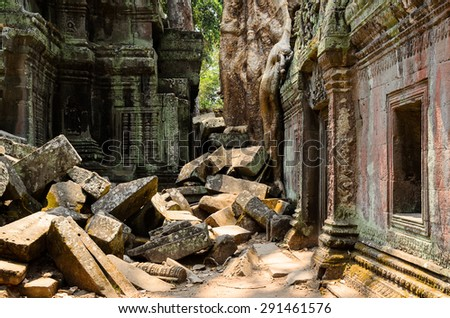 Ta Prohm, part of Khmer Angkor temple complex, popular among tourists ancient landmark and place of worship in Southeast Asia. Siem Reap, Cambodia. - stock photo