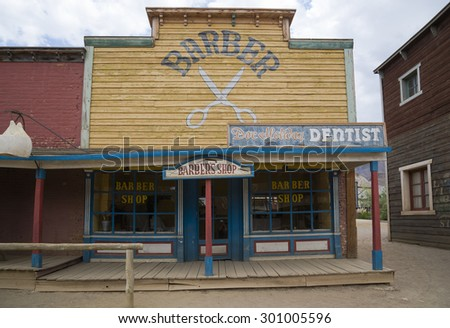 TABERNAS DESERT, ALMERIA, SPAIN - September 19, 2014: barber shop and doctor in the wild west town - stock photo