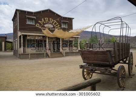 TABERNAS DESERT, ALMERIA, SPAIN - September 19, 2014: Old carriage at the wild west town - stock photo
