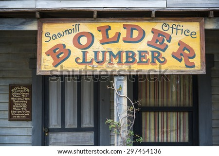 TABERNAS DESERT, ALMERIA, SPAIN - September 19, 2014: Old western town wooden typography sign.   - stock photo
