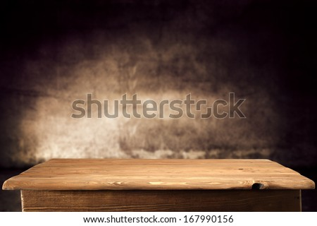 table and brown wall  - stock photo