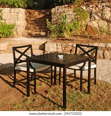 Table and chair in beautiful outdoor cafe alfresco, Italy. square image - stock photo