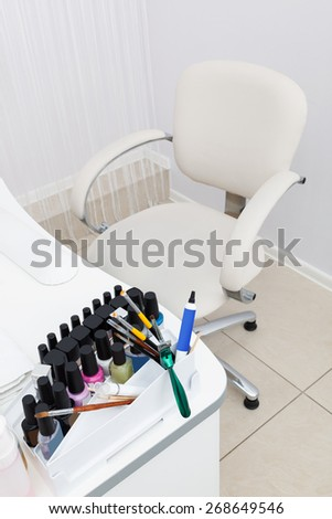table and chair in the manicure room - stock photo